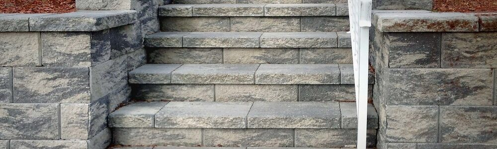 brick steps with railing and retaining wall